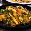 Fried fish with fresh herbs and  spicy sauce served on iron hot — Foto Stock