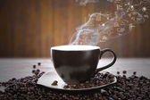 Coffee cup and beans with business graph on smoke — Stock Photo