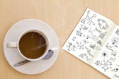 Cup of hot coffee and book with graph on wood table — Stock Photo