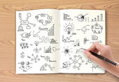 Business concept and graph drawing on book — Stock Photo