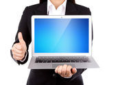Businessperson holding an open laptop with thumb up isolated on — Stock Photo