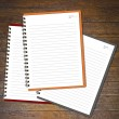 Notebooks (blank paper) on wood wall. — Stock Photo #26955771