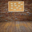 Cork bulletin board with old paper note on brick wall. — Stock Photo #26955913