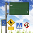 Traffic signs on green grass and blue sky. — Foto de Stock