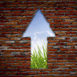 Stock Photo: Brick wall with up arrow ,grass and sky.