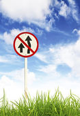 Traffic sign and fresh spring green grass — Stock Photo