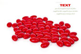 Red medicinal pills on a white background with space for text — Stock Photo