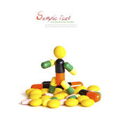Robot (made of capsules and tablets) stand on white background w — Stock Photo