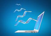 Laptop flying — Stock Photo