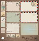 Vector set: Vintage postcard designs, envelopes and stamps. — Vector de stock