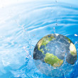 Earth falling into water (Elements of this image furnished by N — Stock Photo