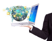Business person holding Laptop with social network on earth (Ele — Zdjęcie stockowe
