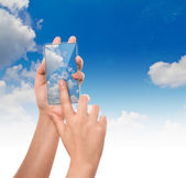 Hand hold cloud computing touch screen mobile phone — Stock Photo