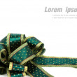 Shiny green ribbon on white background with copy space. — Stock Photo