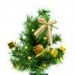 Christmas tree on white background with gifts — Stock Photo