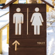Toilet sign with snow — Stock Photo