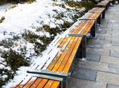 Winter with wooden chairs covered with deep white snow — Stock Photo