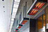 Electric heater with halogen coils at front gate of hotel — Stock Photo