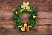 Christmas wreath Over Wooden Background — Stock Photo