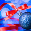 Christmas decoration with red ribbon  and Beautiful Bokeh — Stock Photo