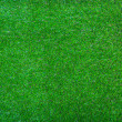 Artificial green grass background texture — Stock Photo #38581741