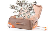 Money in suitcase isolated on white — Stock Photo