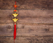Chinese New Year decoration on wood wall — Stock Photo