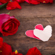Two Heart shaped paper on wood with decoration of red rose - va — Stock Photo