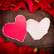Two Heart shaped paper on wood with decoration of red rose - va — Stock Photo #39806841