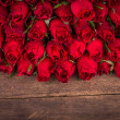 Stock Photo: Rose on wooden background