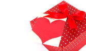 Red valentine gift box and tag — Stock Photo