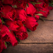 Rose on wooden background — Stock Photo #40187545