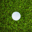 Stockfoto: Golf ball on green grass