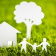 Paper cut of family with house and tree on fresh spring green gr — Stock Photo #41599181