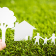 Paper cut of family with house and tree on fresh spring green gr — Stock Photo #41599263