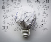 Crumpled paper Light bulb with drawing graph — Stock Photo