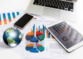 Financial charts on the table with tablet phone and pen  (Elemen — Stok fotoğraf