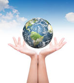 Hands with earth (Elements of this image furnished by NASA) — Stock Photo