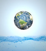 Earth falling into water (Elements of this image furnished by NA — Stock Photo