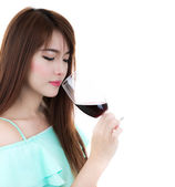 Beautiful girl drinking red wine isolated on white background — Stock Photo