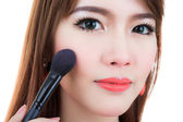 Young woman Make up with Cosmetic Powder Brush — Stock Photo