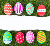 Easter Eggs and  ripped paper on Fresh Green Grass — Stock Photo