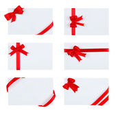 Close up of  card with red ribbon bow on white background — Stock Photo