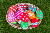 Basket of easter eggs on Fresh Green Grass — Stock Photo