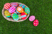 Basket of easter eggs on Fresh Green Grass — Stock Photo