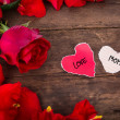 Two Heart shaped paper  on wood with decoration of red rose - Mo — Stock Photo #45670487