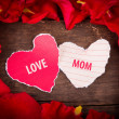 Two Heart shaped paper  on wood with decoration of red rose - Mo — Stock Photo #45670267