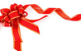 Shiny red ribbon on white background with copy space. — Stock Photo