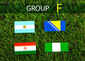 Paper cut of flags on grass for Soccer championship 2014 , group — Stock Photo