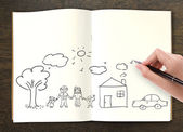 Hand draw in open book of lovely family — Stock Photo